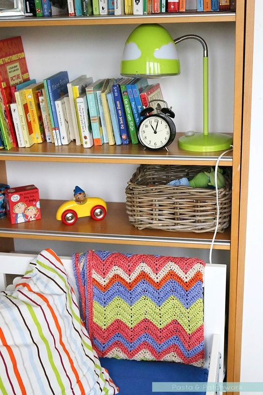 Colourful toddler bedroom - love the mixture of cheaper IKEA items with vintage toys and a handmade crochet blanket