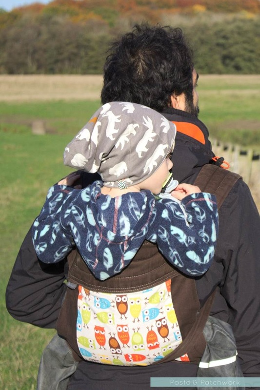 Toddler being carried in the BabyHawk mei-tai style sling